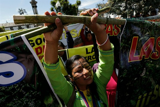 An indigenous woman protests the environmental policies of President Lenin Moreno, in Quito, Ecuador