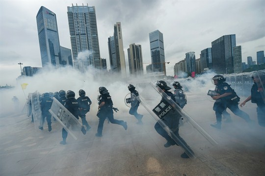 Chinese police officers take part in a drill in Shenzhen city.
