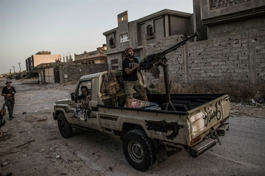 Fighters from Libya's U.N.-backed Government of National Accord clash with forces of the Libyan National Army.