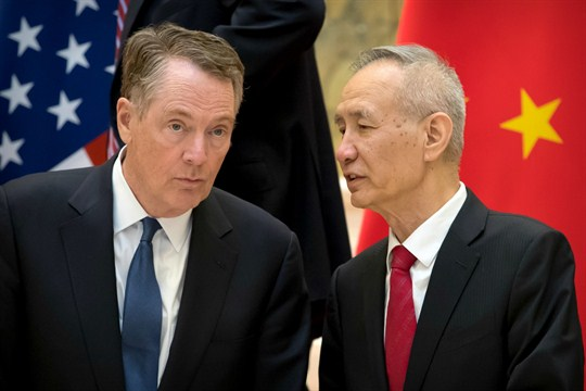Chinese Vice Premier Liu He talks with U.S. Trade Representative Robert Lighthizer.