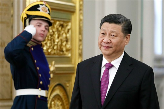 Chinese President Xi Jinping arrives for a meeting with Russian President Vladimir Putin at the Kremlin.