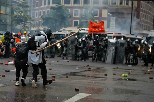 Protesters use bamboo sticks as they face riot police during a protest in Hong Kong.