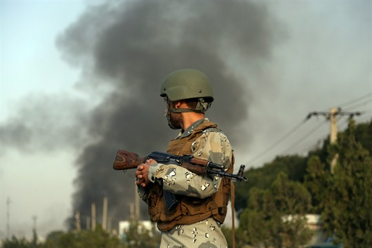 Smoke rises as angry residents set fire to part of the Green Village compound in Kabul.