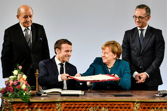 Angela Merkel and Emmanuel Macron, with foreign ministers Heiko Maas and Jean-Yves Le Drian, in Germany