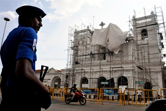 A military officer patrols outside the bombed St Anthony's Church, currently under reconstruction, in Colombo.