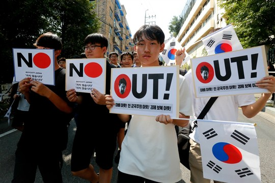 South Korean students march in a rally against Japan in Seoul, South Korea