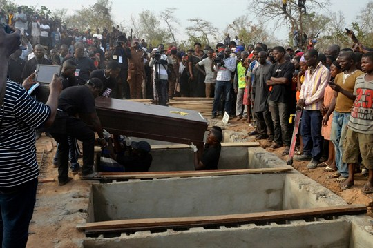A mass funeral in Nigeria after 70 people were killed in attacks blamed on Fulani herders.