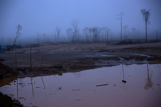 Deforestation caused by gold mining in what was once a rainforest on the Peru-Bolivia border.