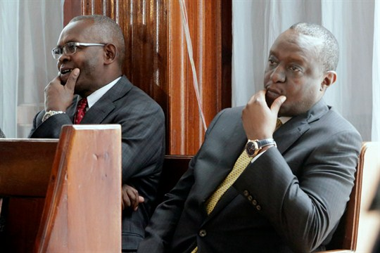 Kenyan Finance Minister Henry Rotich and his principal secretary, Kamau Thugge, at a court in Nairobi.