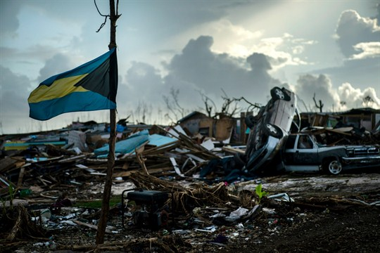 The national flag of the Bahamas flies in Abaco amid the rubble left by Hurricane Dorian.