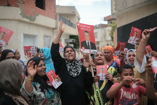 Supporters of jailed media magnate Nabil Karoui chant for his freedom in Nabeul, Tunisia