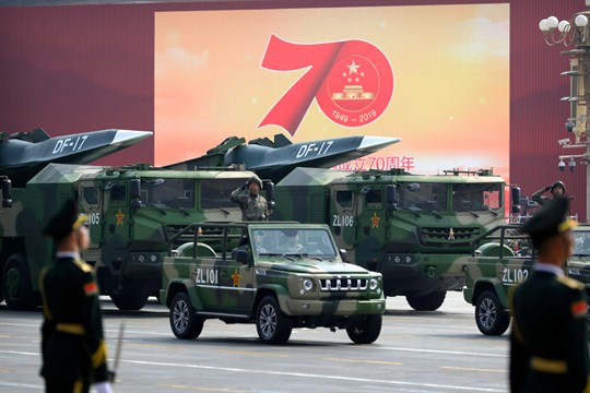 Chinese military vehicles carry DF-17 ballistic missiles during a parade in Beijing.