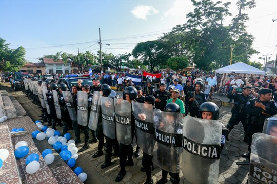 Police form a line outside a church during a demonstration for the freedom of political prisoners.