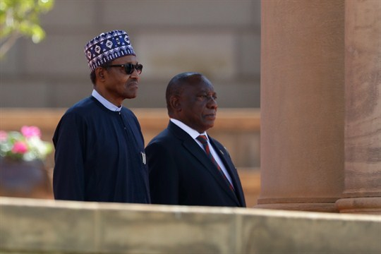 Nigerian President Muhammadu Buhari and South African President Cyril Ramaphosa at a welcoming ceremony in Pretoria.