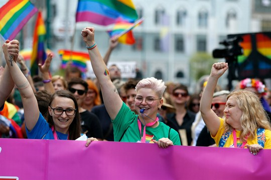 LGBT activists marching in Bosnia's first-ever Pride parade in downtown Sarajevo.