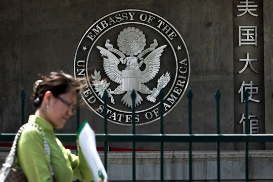 A Chinese woman walks past the U.S. Embassy in Beijing, China.