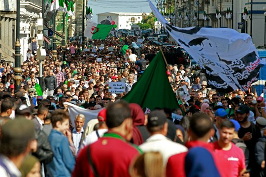 Algerian students take to the streets of Algiers to protest against the government.