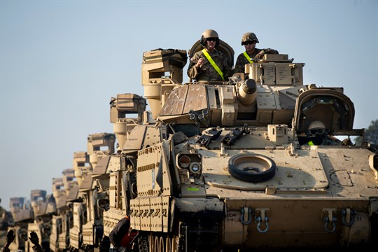 U.S. soldiers on Bradley Infantry Fighting Vehicles before the Atlantic Resolve military exercise outside Vilnius, Lithuania.