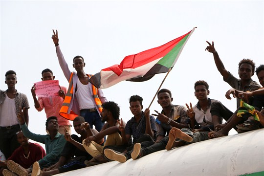 Sudanese pro-democracy supporters celebrate a final power-sharing agreement with the ruling military council in August.