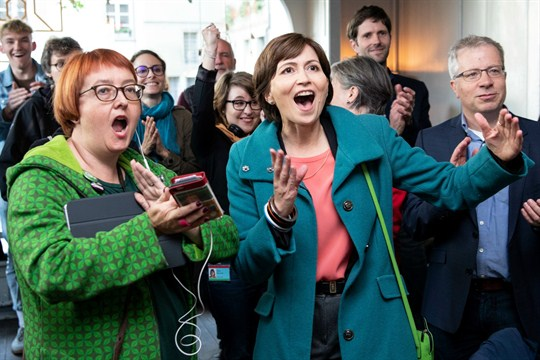 Members of Switzerland's Green party react to the results of October elections.