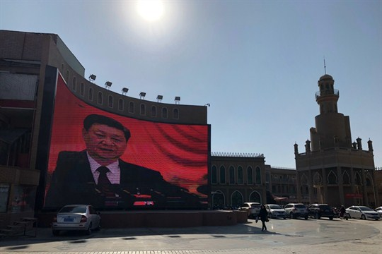 Chinese President Xi Jinping seen on a video wall in the western Chinese city of Kashgar