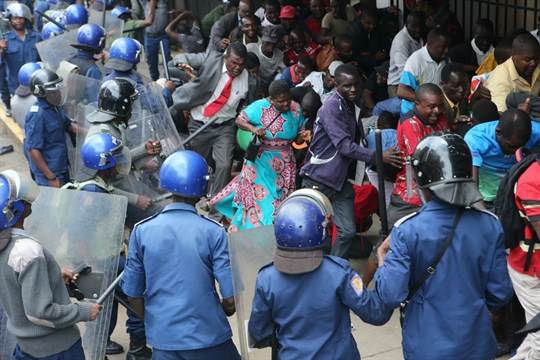 Police in Zimbabwe surround supporters of opposition leader Nelson Chamisa during a crackdown in Harare.