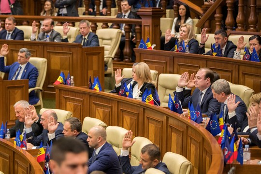 Moldovan members of parliament vote for a no-confidence motion against the Prime Minister Maia Sandu's government.