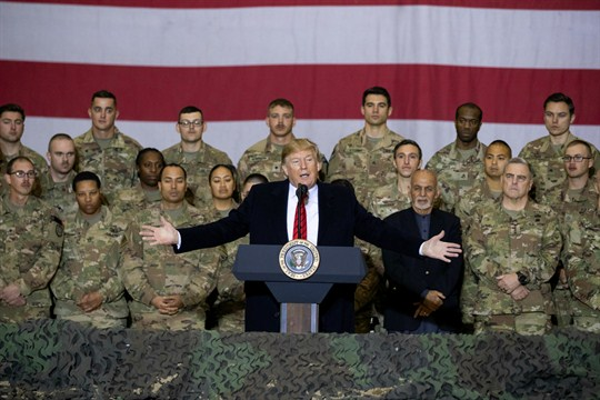 President Donald Trump addresses members of the military during a surprise Thanksgiving Day visit to Afghanistan.