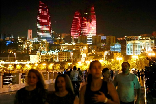 People stroll in a park along the Caspian Sea in Baku, the capital of Azerbaijan.