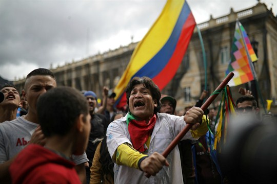 An antigovernment protester chants during a demonstration in Bogota, Colombia.