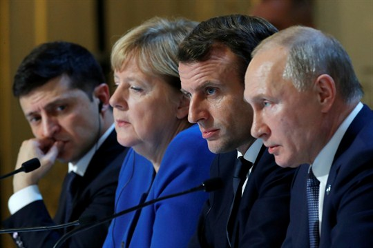The leaders of Ukraine, Germany, France and Russia at a joint news conference in Paris