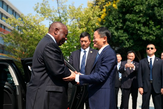 South African President Cyril Ramaphosa, left, shakes hands with Jack Ma in Hangzhou city, China