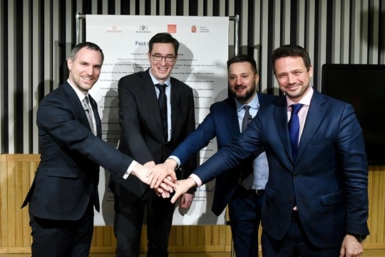 The mayors of Prague, Budapest, Bratislava and Warsaw pose after signing the Pact of Free Cities.
