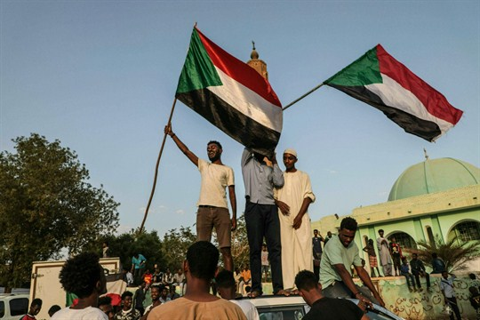 Sudanese people celebrate in the streets of Khartoum