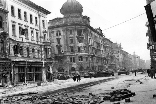 Russian tanks stand in a street in Budapest during the Hungarian uprising of 1956.