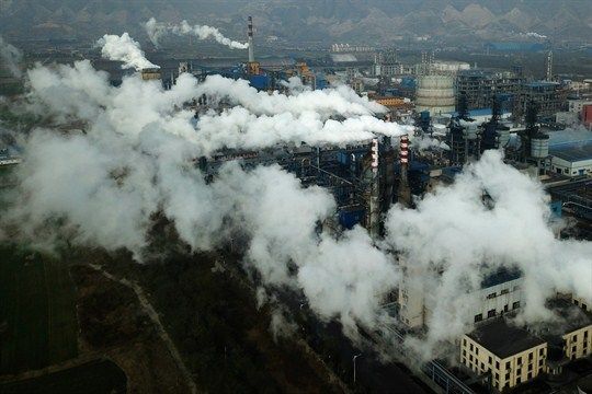 Smoke and steam rise from a coal processing plant in Hejin in central China's Shanxi Province.