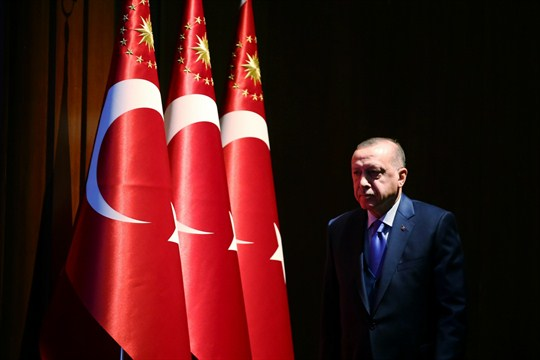 Turkish President Recep Tayyip Erdogan arrives to deliver a speech at an event in Ankara