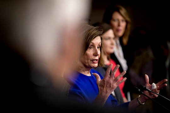 House Speaker Nancy Pelosi discusses the USMCA trade agreement at a news conference in Washington