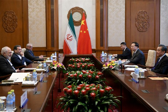 Chinese Foreign Minister Wang Yi talks to Iranian Foreign Minister Mohammad Javad Zarif during a meeting