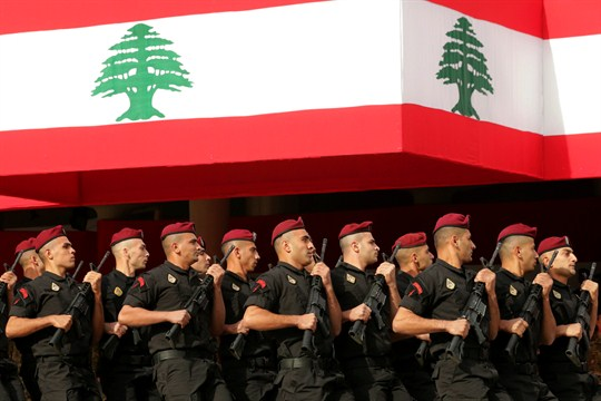 Lebanese marine special forces soldiers march during a military parade in Beirut.