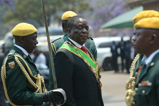 Zimbabwean President Emmerson Mnangagwa inspects the guard of honor during the opening session of Parliament
