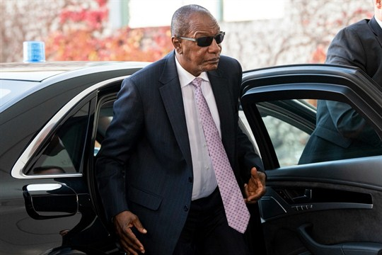 Guinean President Alpha Conde arrives at a conference in Berlin, Germany.