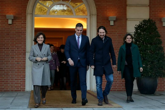 Spanish Prime Minister Pedro Sanchez and Podemos leader Pablo Iglesias leave the Moncloa Palace in Madrid