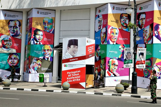 A building with posters of former Asian and African leaders