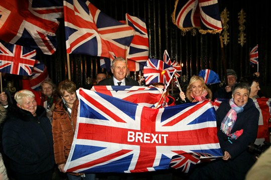 Brexit supporters celebrate the U.K.'s official exit from the European Union at a rally in Belfast.