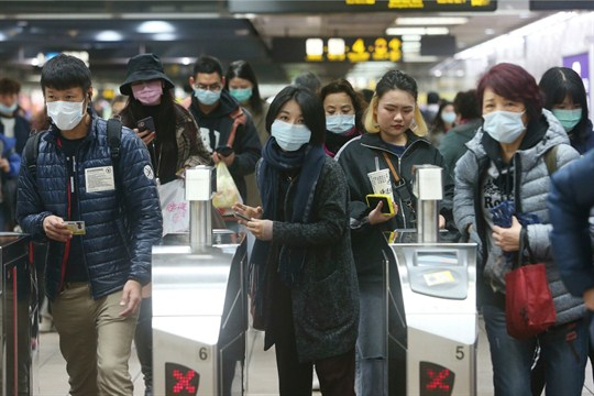 Commuters in masks at a metro station in Taipei. Taiwan has 13 cases of coronavirus.