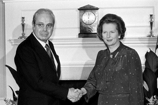 U.N. Secretary-General Javier Perez de Cuellar shakes hands with British Prime Minister Margaret Thatcher in 1982