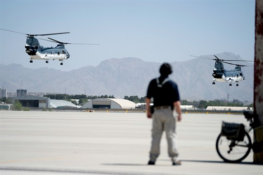 Helicopters with Secretary of State Mike Pompeo aboard take off at Camp Alvarado in Kabul, Afghanistan.