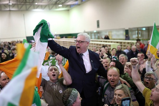 Thomas Gould of the Sinn Fein party celebrating with supporters after the Ireland elections.