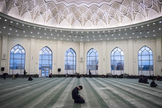 A man prays inside the Minor Mosque in Tashkent, Uzbekistan.